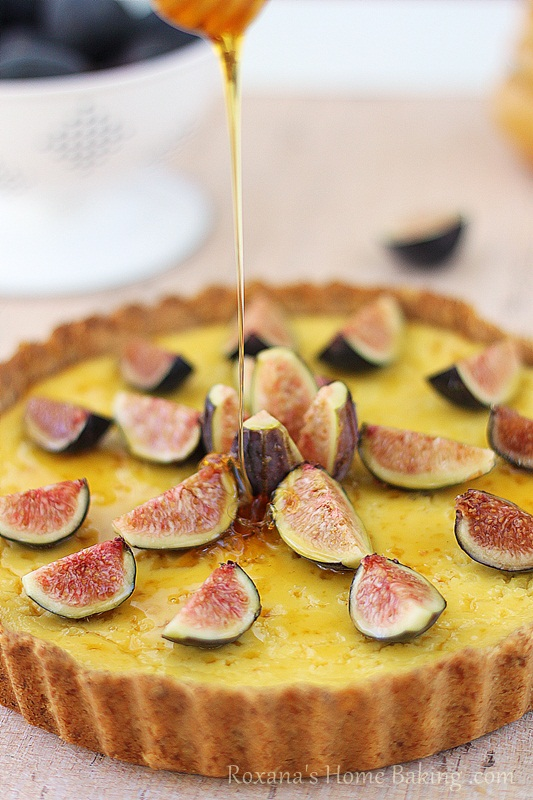 A creamy, sweet ricotta tart brushed with honey and decorated with fragrant fresh figs. Recipe from roxanashomebaking.com
