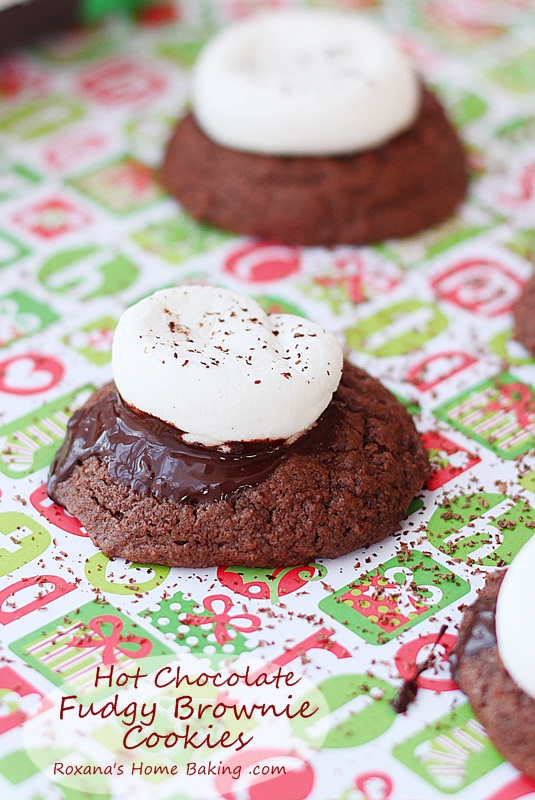 Hot chocolate fudgy brownie cookies topped with oozing chocolate and a gooey marshmallow. A delicious way to impress your loved ones. Recipe from Roxanashomebaking.com