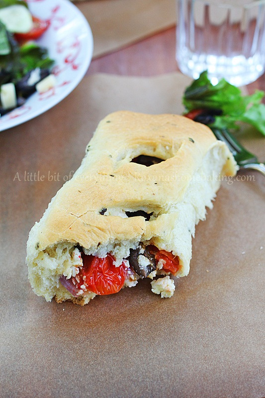 Flavorful olive oil bread filled with tomatoes, onion, olives and feta cheese making a delicious weeknight dinner