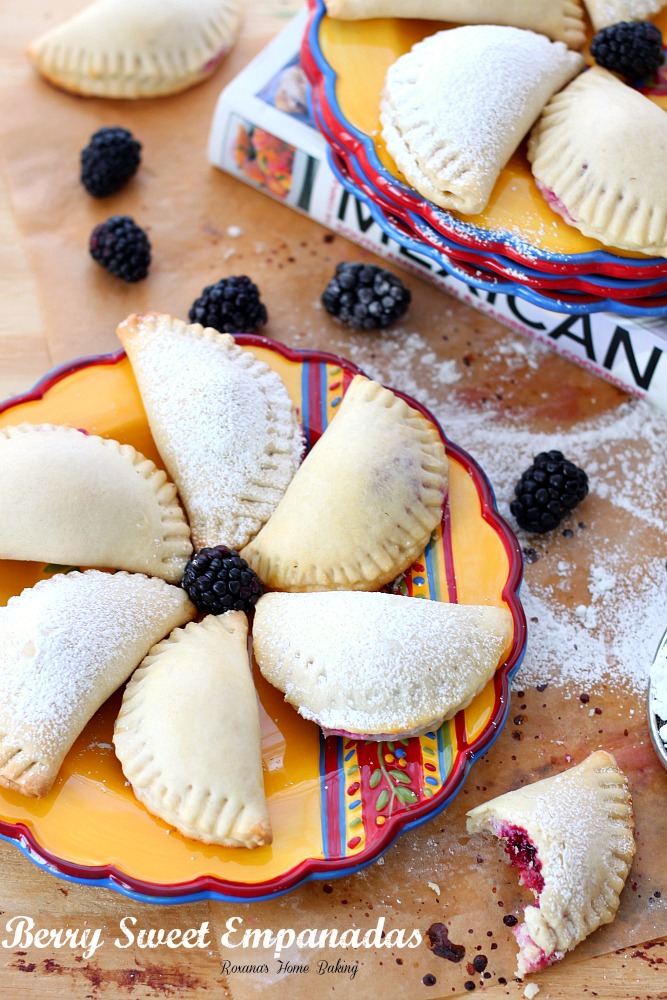 Flaky pastry pockets filled with creamy ricotta and a juicy blackberry from Roxanashomebaking.com A sweet twist on traditional empanadas.